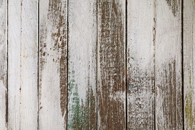 Oude grunge gekleurde verticale patroon houten hek