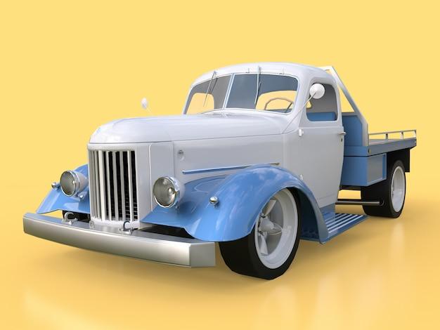 Oude herstelde witte en blauwe auto op geel