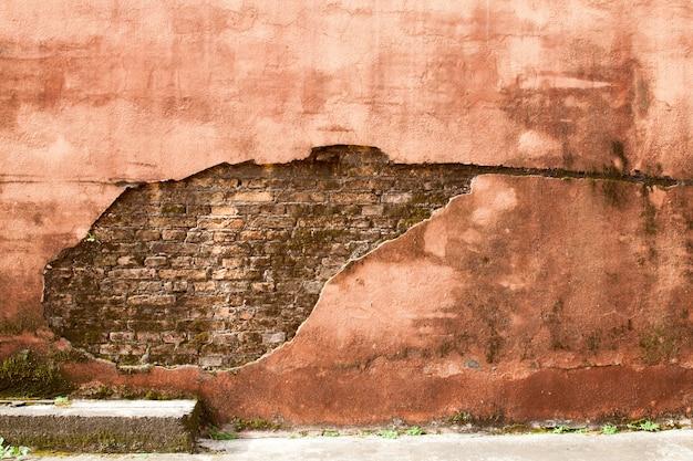 Oude het patroontextuur van de baksteen oranje muur