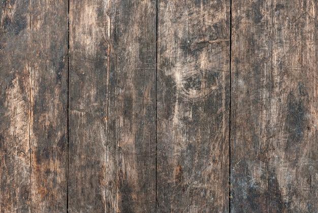 Oude houten achtergrond, oppervlak geërodeerd door de tijd