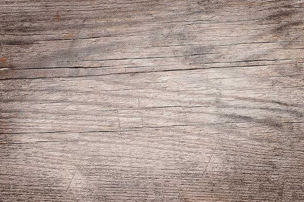 Oude houten gebarsten geweven bruine achtergrond