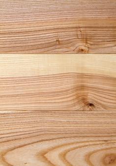 Oude houten gele of bruine textuurachtergrond. boards of panelen verticaal beeld
