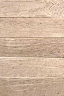 Oude houten gele of bruine textuurachtergrond. borden of panelen verticale afbeelding Premium Foto
