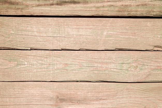 Oude houten planken borden met gescheurd reliëf en verfresten textuur van oud hout.