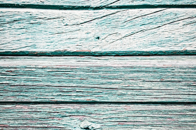 Oude houten planken met afbladderende verf. oud bord. effect van weer op hout.