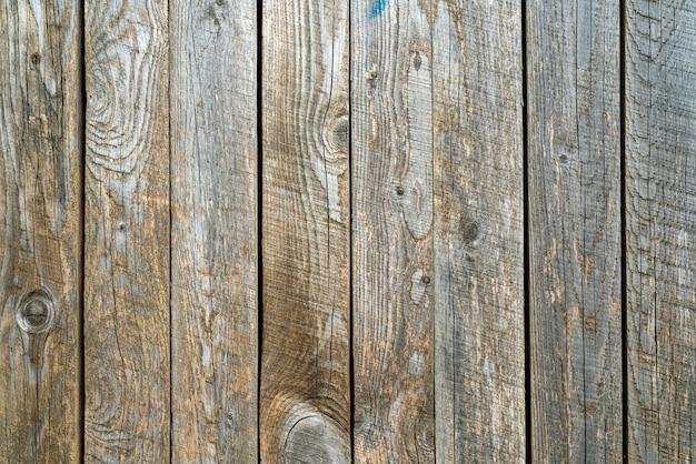 Oude houten vintage planken bedekt met schilferige bruine verf. hout textuur.