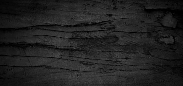 Oude houtstructuur. zwarte houten achtergrond. hout is aan het eroderen. houten grungeachtergrond.