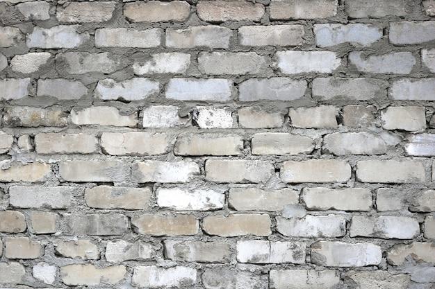 Oude lelijke bakstenen muur horizontale textuur. stenen muur