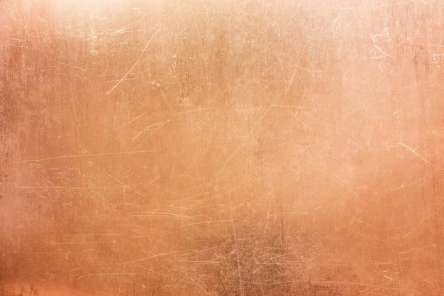 Oude messing of koperen achtergrond, textuur van een vintage oranje metalen plaat