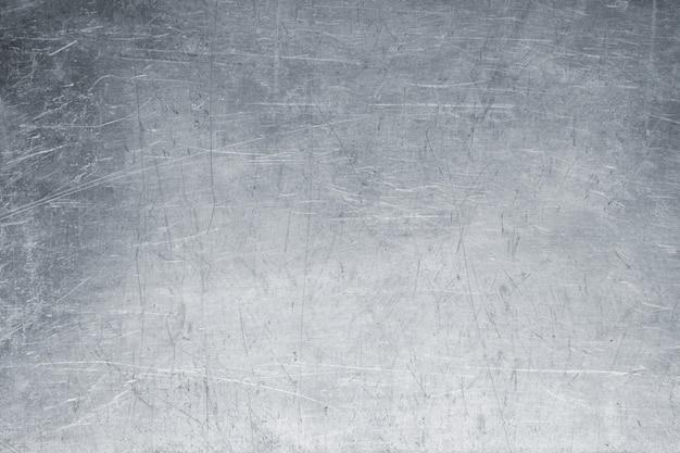 Oude metaalachtergrond, heldere ijzerextuur, versleten borstel of sandpap