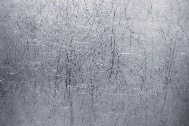 Oude metalen achtergrond, lichte ijzeren textuur, versleten borstel of schuurpapier
