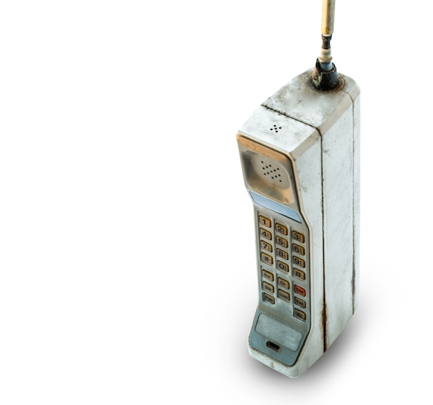 Oude mobiele telefoon geïsoleerd op wit