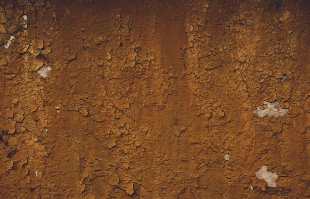 Oude muur met barstenachtergrond