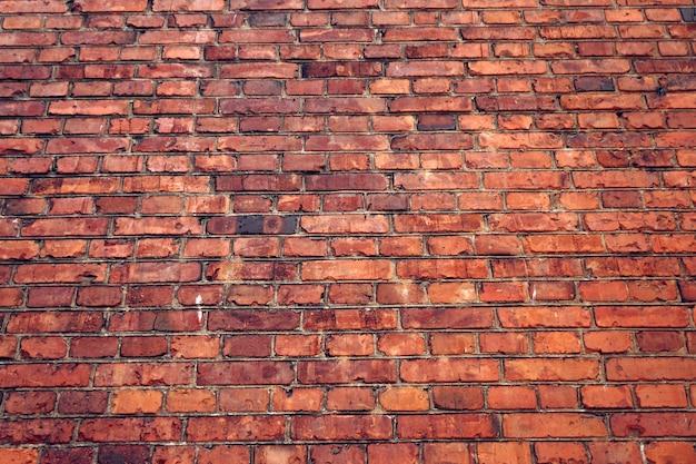 Oude muur van rode baksteen. grunge textuur.