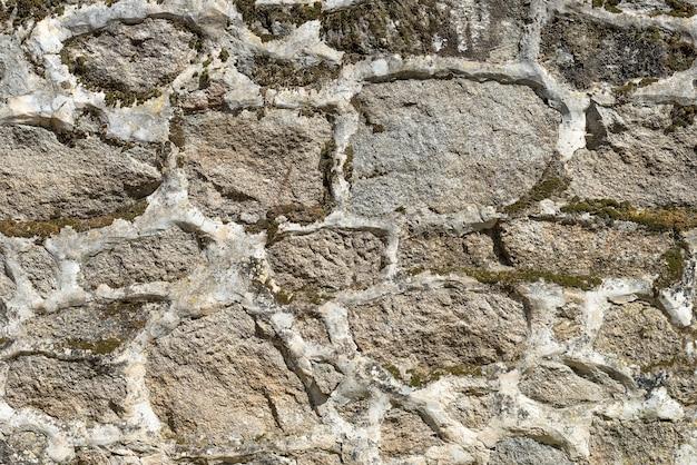 Oude muur van steen close-up, achtergrond, textuur