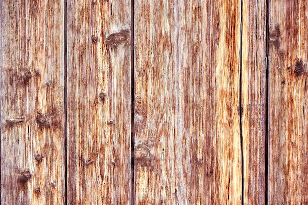 Oude noodlijdende bruin terracotta koper roestige houten achtergrond met ruwe textuur veelkleurige insluitsels. stained gradient grof korrelig oppervlak.