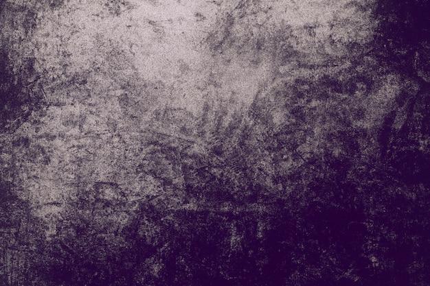 Oude noodlijdende zwarte grunge donkere rommelige achtergrond grunge cement patroon achtergrondstructuur.