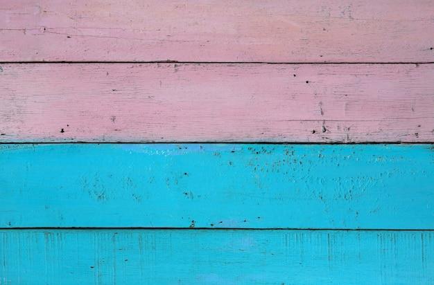 Oude pastel geschilderde houten muur