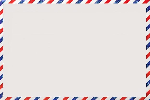 Oude post gestreepte envelop, achtergrond met kopie ruimte, postbrief met gestripte vintage