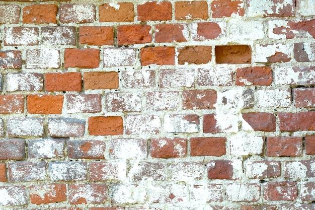 Oude rode bakstenen muur als achtergrond vooraanzicht horizontale close-up