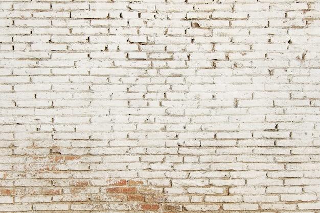 Oude rode bakstenen muur met witte verf achtergrondstructuur