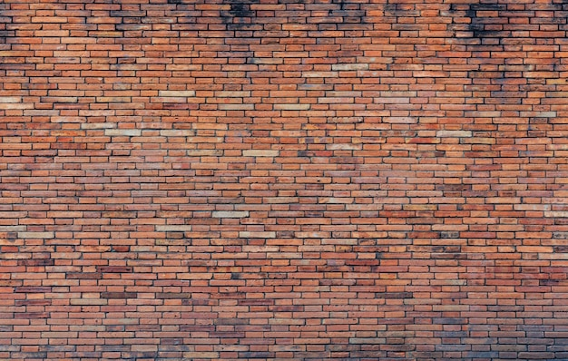 Oude rode bakstenen muur
