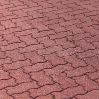 Oude rode bakstenen voetpad