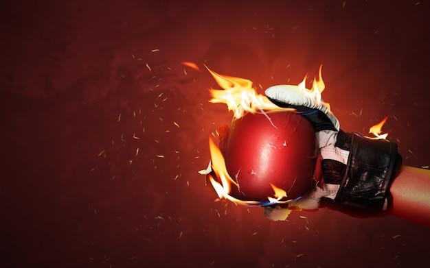 Oude rode bokshandschoenen op hete fonkelingenachtergrond met extreme brandvlam en fel het vechten hand voor winnaar of succesconcept.