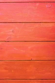 Oude rode geschilderde raadsachtergrond. houten panelen op een rustieke schuur