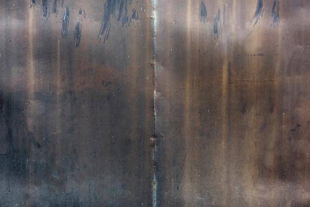 Oude roestige ijzeren plaat opgedoken achtergrond
