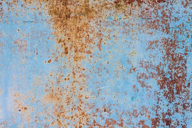 Oude roestige metaalachtergrond met gebarsten verf