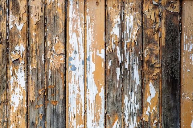 Oude rustieke houten muur met gebarsten verfachtergrond