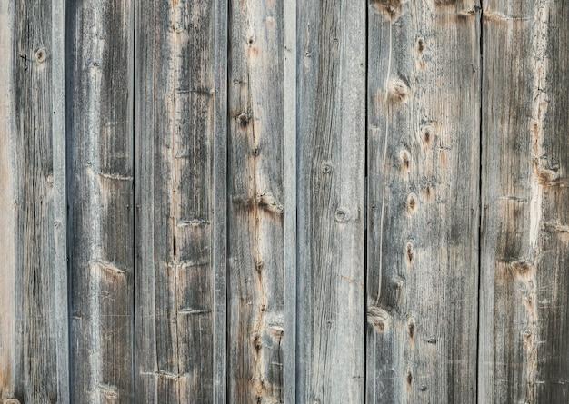 Oude ruwe verkleurde houten textuurachtergrond