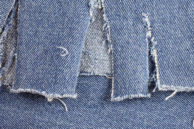 Oude spijkerbroek achtergrond.