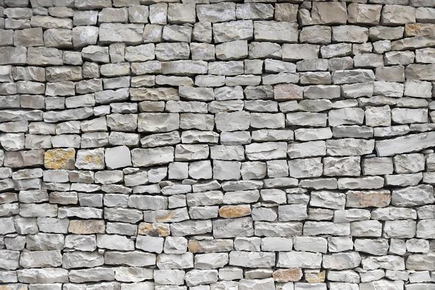 Oude stenen muur, abstracte achtergrond.
