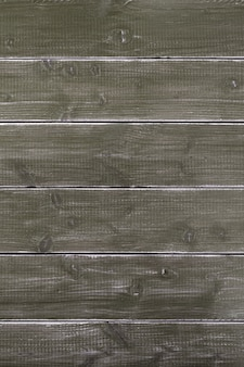 Oude uitstekende donkere bruine houten oppervlakte als achtergrond