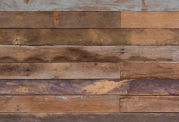 Oude uitstekende grungy roodbruine houten texturen als achtergrond