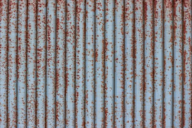 Oude van het het bladdak van het grunge roestige blauwe metaal achtergrond van de de textuurmuur.