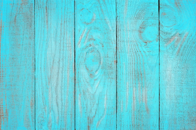Oude verweerde houten plank geschilderd in turquoise blauwe kleur