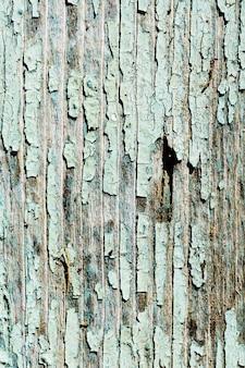 Oude, verweerde planken met afbladderende verf