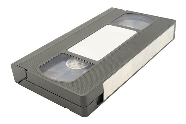 Oude videocassetteband op witte achtergrond.