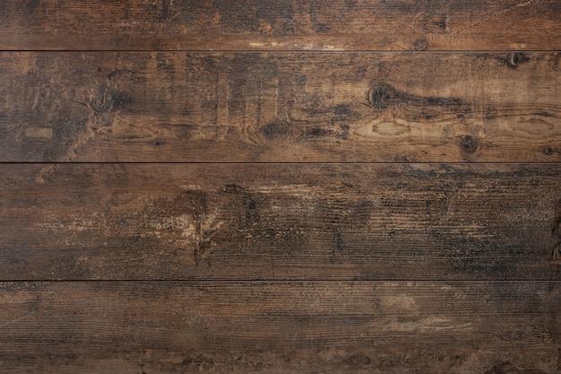 Oude vintage donkerbruine houten geweven tafel