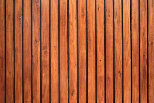 Oude vintage roodbruine houten latwandbekleding