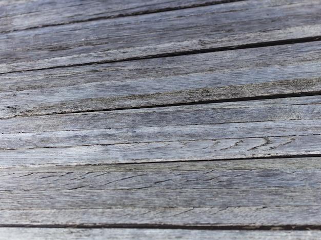 Oude vuile houten grijsbruine textuur