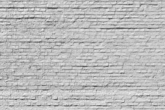 Oude witte bakstenen muur achtergrond