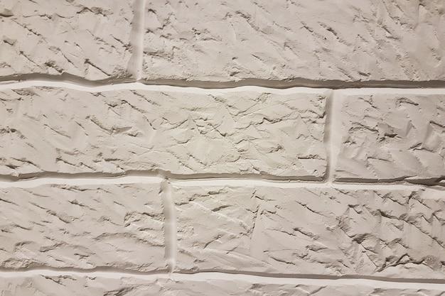 Oude witte bakstenen muur