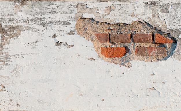 Oude witte betonnen muur
