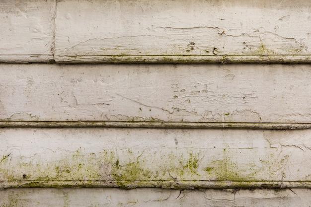 Oude witte houten planken op een huismuur. structuur