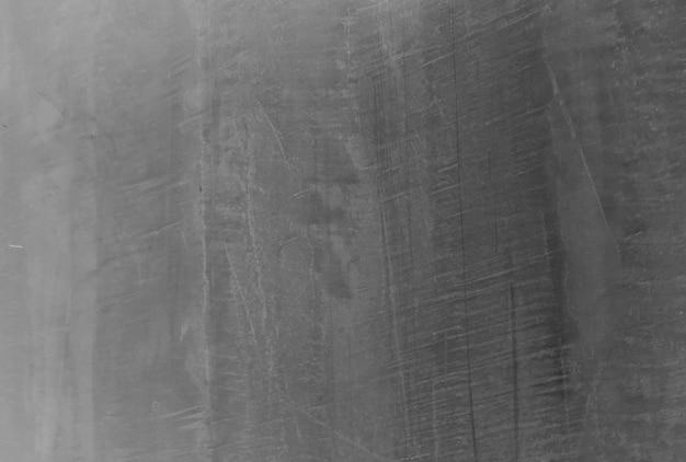 Oude zwarte achtergrond. grunge textuur. donker behang. schoolbord schoolbord beton.