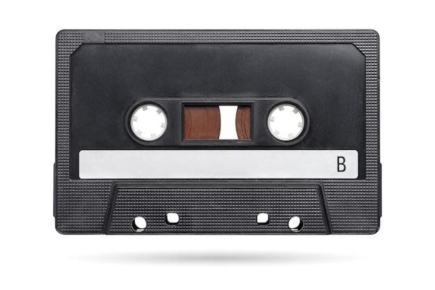 Oude zwarte audio tape compact cassette geïsoleerd